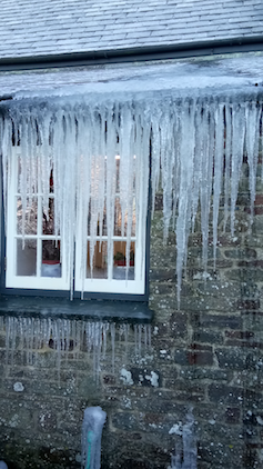 Icicles hanging from the roof of the Rectory during The Beast from The East 2018