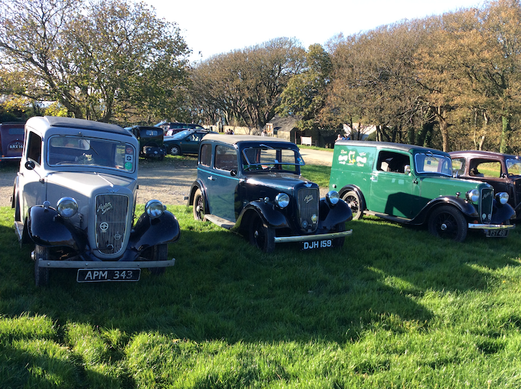 Cars parked on the grass outside the rectory tearooms