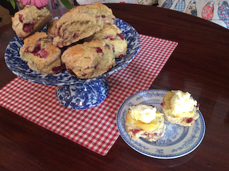An Image of Our Delicious Raspberry Scones with Lemon Curd and Clotted Cream
